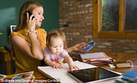 Smarty-pants: smart mums give restless babies smartphone apps to play with