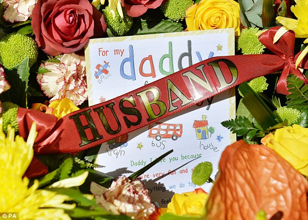 'For my daddy': Flowers and a card tied to a wreath believed to have been left by the family of Drummer Rigby
