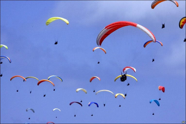 Ninety-nine paragliders in the air at Nusa Dua, Bali, Indonesia