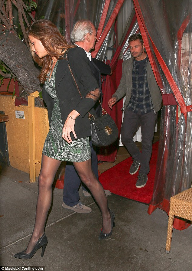 Lucky guy: Ryan Seacrest enjoyed dinner in Los Angeles with a mystery brunette on Saturday night.
