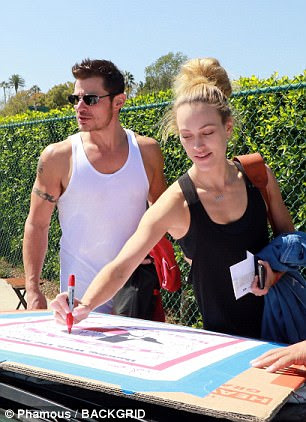 Stepping up: DWTS partner Peta Murgatroyd, 31, also signed the poster