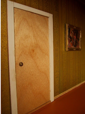 Wooden door in a vintage Lundby dolls' house.