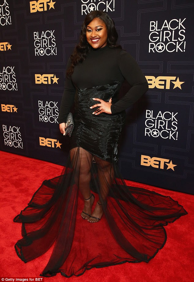 Vamping it up! Jazmine Sullivan made quite the fashion statement in her sexy and sheer floor-length dress
