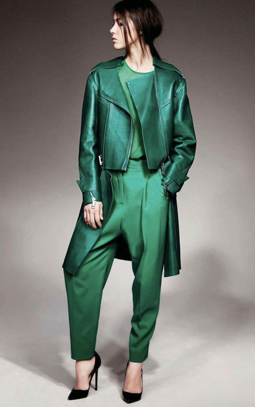 LE FASHION BLOG EDITORIAL SISTERS JALOUSE MAGAZINE EMERALD GREEN ALL GREEN LOOK METALLIC LONG ZIPPER TRENCH MOTO JACKET  GREEN DROP CROTCH PANTS SHEER GREN TOP BLACK SUEDE HEELS PUMPS PONYTAIL