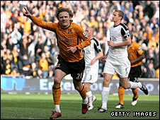 Hull's Jimmy Bullard celebrates his goal against Fulham