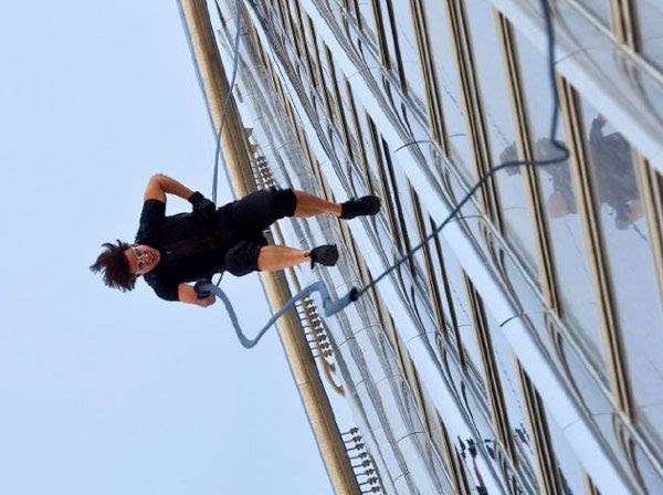 Ethan Hunt (Tom Cruise) runs down the side of the Burj Khalifa skyscraper in MISSION: IMPOSSIBLE - GHOST PROTOCOL.