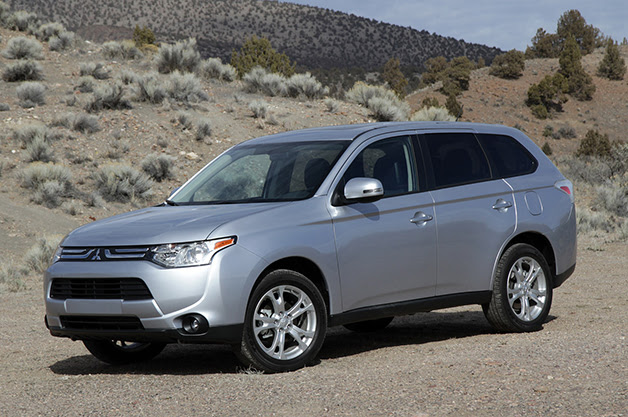 2014 Mitsubishi Outlander PHEV, front three-quarter view.