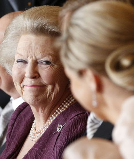 Queen Beatrix of the Netherlands (C) smiles at her son Prince Willem-Alexander