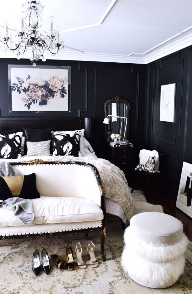 Black and navy paint on bedroom walls creates a dark space for sleeping while allowing colors and white to pop against the dark color. #bedroom