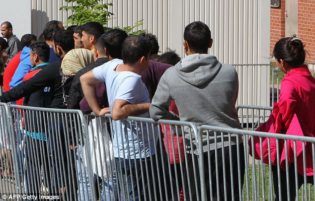 Refugees line up at a temporary shelter for asylum seekers in Giessen, western Germany. The United Nations is planning for the displacement of 500,000 people from the Iraqi city of Mosul if Iraqi forces launch an attempt to recapture it from Islamic State
