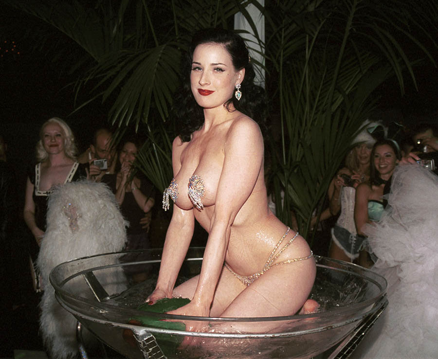 Burlesque performer Dita Von Teese performs her martini dance during a Playboy mansion party