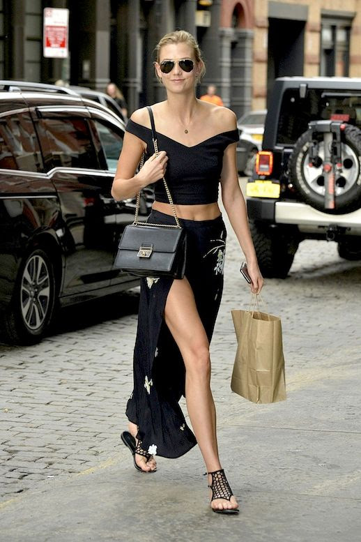 Le Fashion Blog Model Style Karlie Kloss Aviator Sunglasses Black Off The Shoulder Crop Top Chain Strap Bag Thigh Slit Floral Printed Skirt Mesh Style Sandals Via Harpers Bazaar