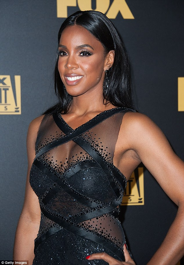Shimmering star: Kelly Rowland looked stunning in a black gown with sheer panels that showed off her cleavage atthe Fox Golden Globes After-Party at Chateau Marmont in Hollywood on Sunday evening