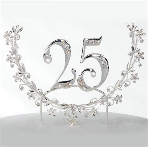 Roman 25th anniversary cake topper picture.PNG (1 comment)