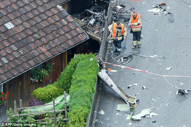 Tragedy: The 50-year-old pilot was inside his plane when it crashed into a barn in Dittingen in  Switzerland