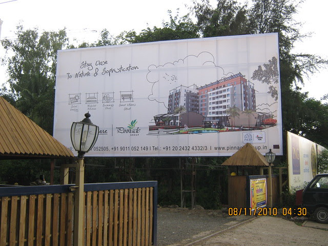 Pinnacle Cottage Close - hoarding at the main gate of 'Abhiruchi Village' on Sinhagad Road Pune 411 041