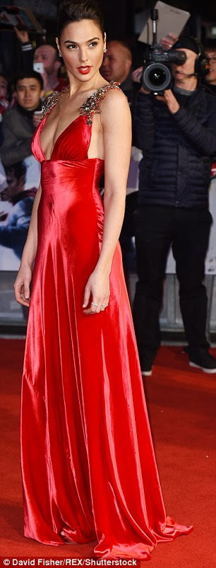 Belle of the ball: The Israeli actress trumped the style game hands down as she glided into the cinema in the scarlet silk number