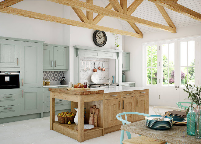 Rustic European kitchen. aga aga over mantel chopping board chopping boards clock exposed beams exposed brick splashback fruit basket fruit bowl jug kitchen beams kitchen island mint green modern kitchen painted brick painted kitchen sage green saucepan rail traditional kitchen Kitchen Stori