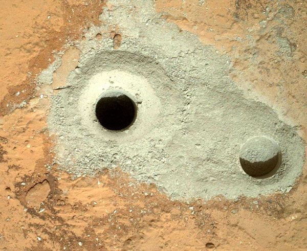 An image of the two holes made by the drill at the end of the Curiosity Mars rover's robotic arm, taken on February 8, 2013.