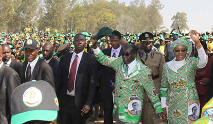 Republic of Zimbabwe President Robert Mugabe and First Lady Amai Grace at the ZANU-PF campaign launch in Highfield. The rally took place on July 5, 2013. by Pan-African News Wire File Photos