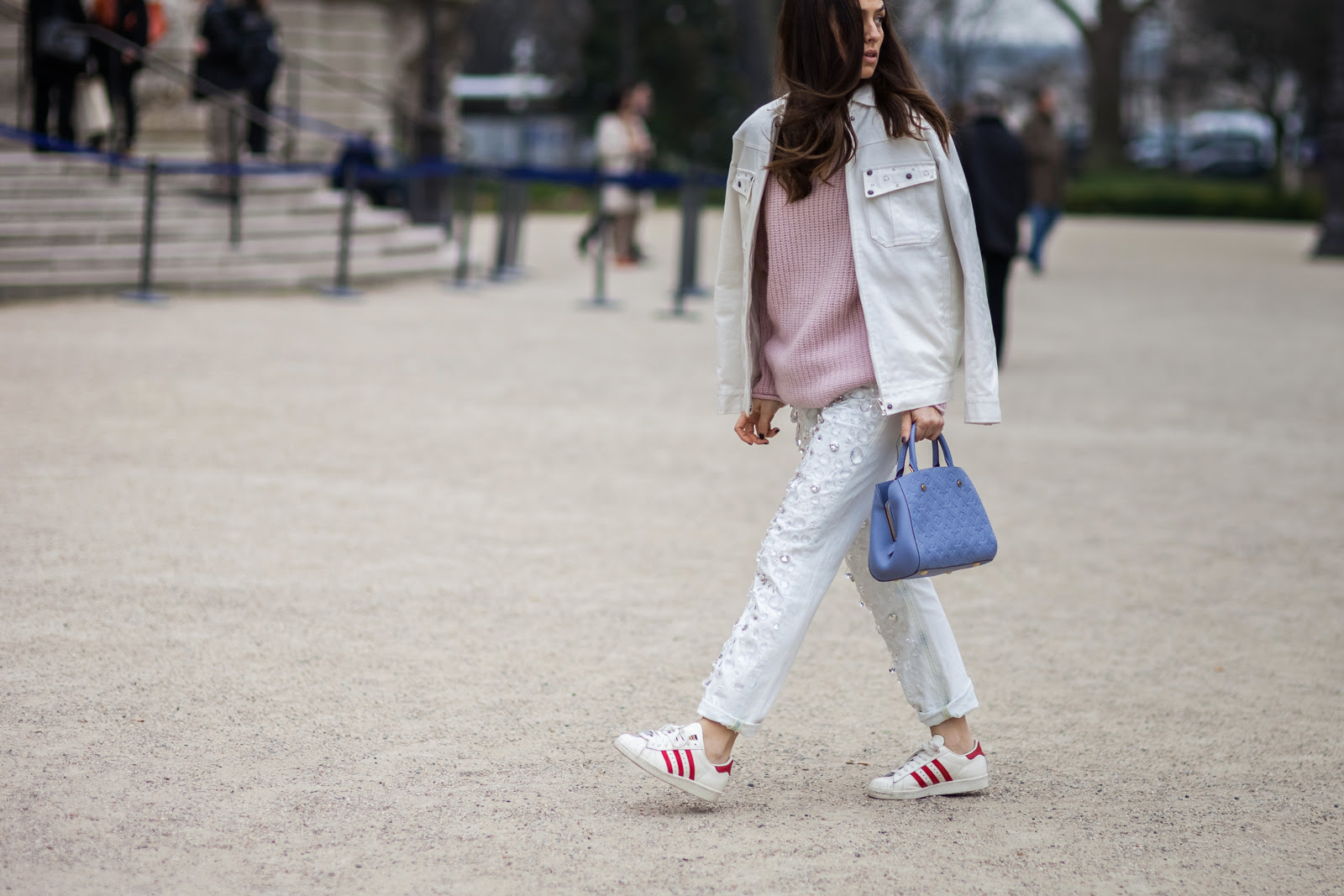 Erika Boldrin wearing Dondup embellished jeans, pink sweater, white denim jacket, Louis Vuitton bag and Adidas sneakers before the Chanel Fall/Winter 2015-2016 fashion show in Paris, France