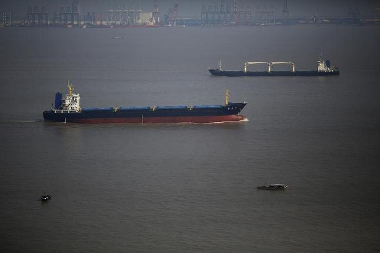 Ships sail on the Yangtze river near Shanghai November 5, 2013. REUTERS/Carlos Barria