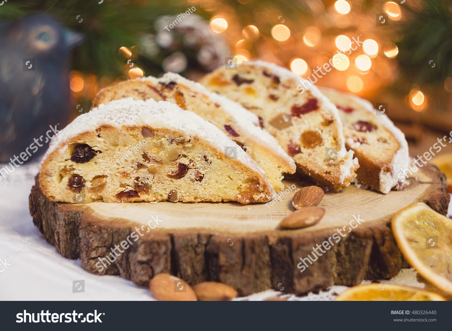 http://www.shutterstock.com/pic-480326440/stock-photo-slices-of-stollen-on-festive-rustic-wooden-background-with-cchristmas-light-bokeh-shallow-focus.html