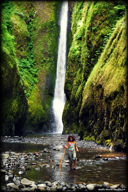 A young hiker at the waterfall at the end of Oneonta Gorge