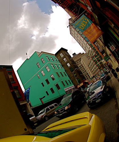 Fisheyed Soho with a green building