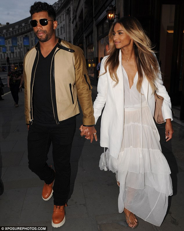 The picture of marital bliss: The duo looked in great spirits in London after marrying in Cheshire