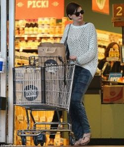 Anne Hathaway wearing grey open weave sweater