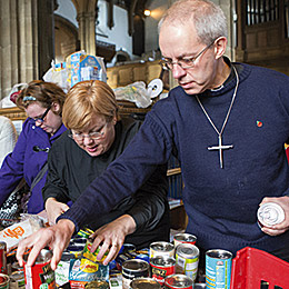 Archbishop Justin helping at a foodbank