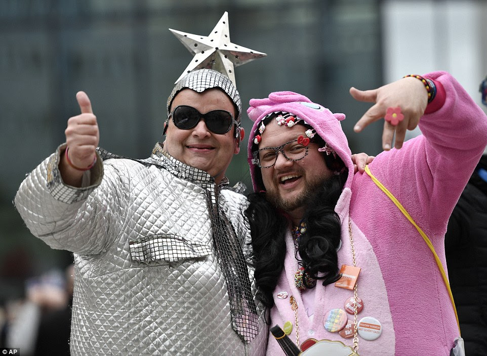 Fans Andreas and Thorsten from Germany posed in a fetching pink onesie and a futuristic silver space suit