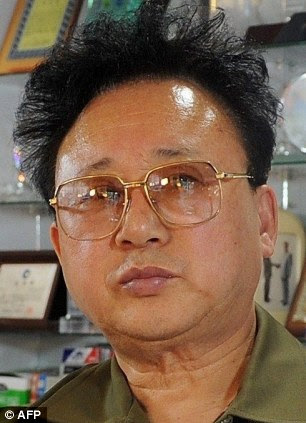 Look-a-like: South Korean engraver Kim Young Sik has impersonated Kim Jong Il for more than a decade