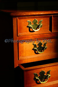 an opened drawer of an antique jewelry box