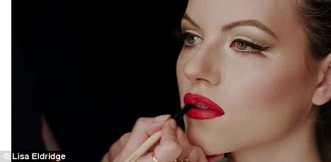 Get the look: Lisa paints on the perfect rouge red lipstick