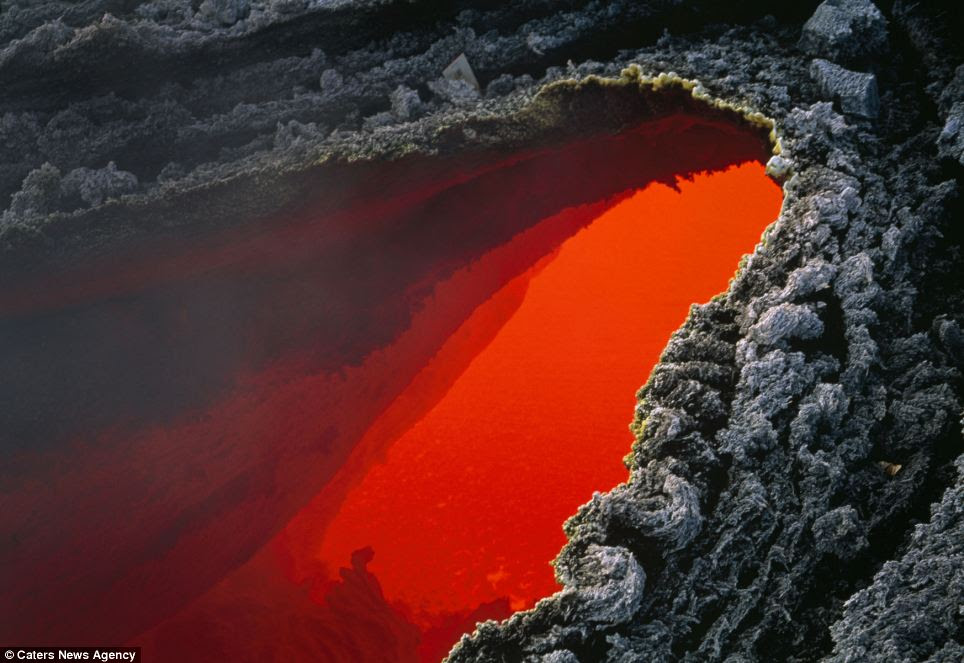 Contrasts: The bright orange and red liquid lava and and molten lava stands out next to the background of the grey cooled mountain
