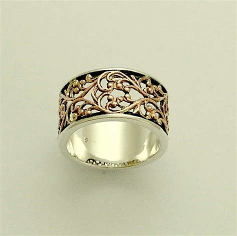 Sterling silver and rose gold filigree wedding band
