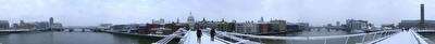 Photo of the Millennium Bridge and the city of London covered in snow, taken on 2009-02-02