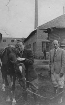 Oskar Schindler (left) at his enamel works in Zablocie, a suburb of Krakow. Poland, 1943-1944.