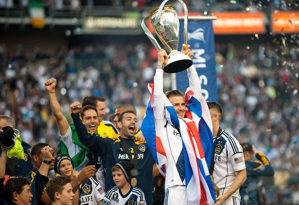 David Beckham hoists up the MLS Cup trophy after the Los Angeles Galaxy defeats the Houston Dynamo, 3-1, at The Home Depot Center...on December 1, 2012.