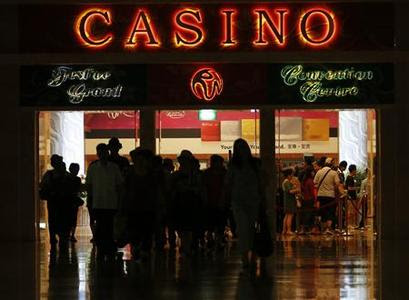 Guests leave the lobby area of the Sentosa Resorts World Casino in Singapore April 8, 2013. High-rollers get lavish treatment and hefty credit lines at Singapore's two casinos, like any other gaming house in the world. But here, more of them skip town without paying their debt, a matter of increasing concern for investors. REUTERS-Edgar Su