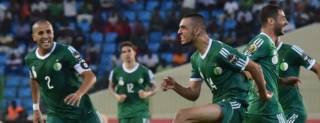 Nabil Bentaleb (second right) shows his delight after scoring Algeria's second goal