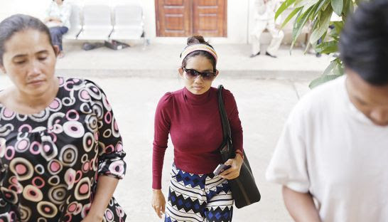 Land rights activist Yorm Bopha arrives yesterday at the Appeal Court in Phnom Penh, where she was handed a three-year, largely suspended sentence for intentional violence.