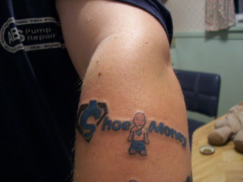 cool guy tattoos. If a guy tattoo your name onto