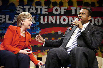 """Hillary Clinton and Tavis Smiley speaks to the crowd at the """"State Of The Black Union"""" symposium on February 23, 2008 in New Orleans."""
