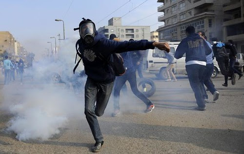Egyptian clashes with police on December 20, 2013. The protesters were opposing the military-backed regime in Cairo. by Pan-African News Wire File Photos