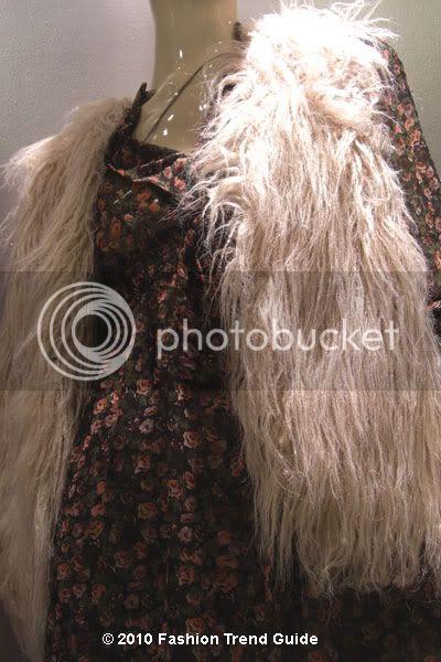 white shaggy faux fur vest