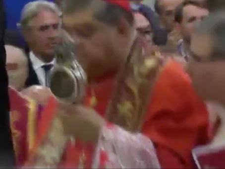 Italy Cardinal holds blood