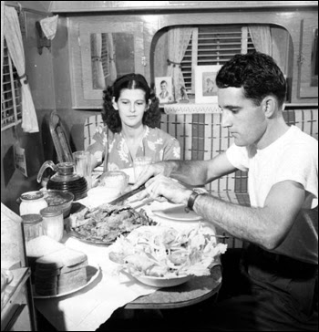 Al and Roey Stickles sit down to have a meal: Everglades National Park, Florida (1946)
